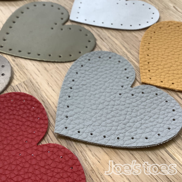 Joe's Toes toffee heart shaped patch with stitch holes