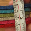 showing thickness of Joe's Toes thick wool felt approx 4.5mm