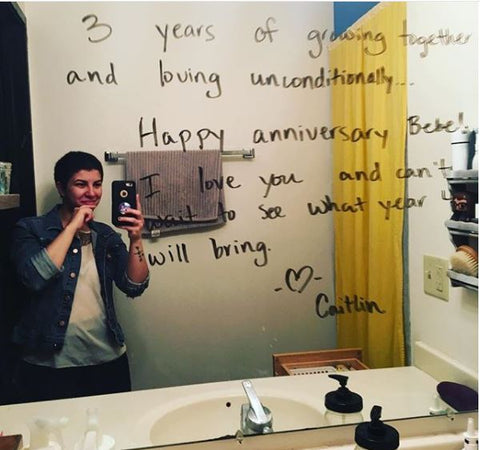 Leaving a love note on the mirror for anniversary