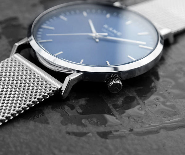 KANE Watches minimal designed watches for men featuring interchangeable straps. All men's watches only €99.00 with free express shipping. The blue Arctic Face Featuring Silver Stainless Steel Mesh Strap.