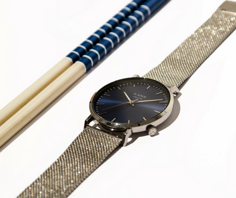 KANE Watches minimal designed watches for men featuring interchangeable straps. All men's watches only €99.00 with free express shipping. The Blue Arctic Face Featuring Silver Stainless Steel Mesh Strap set on chop sticks.