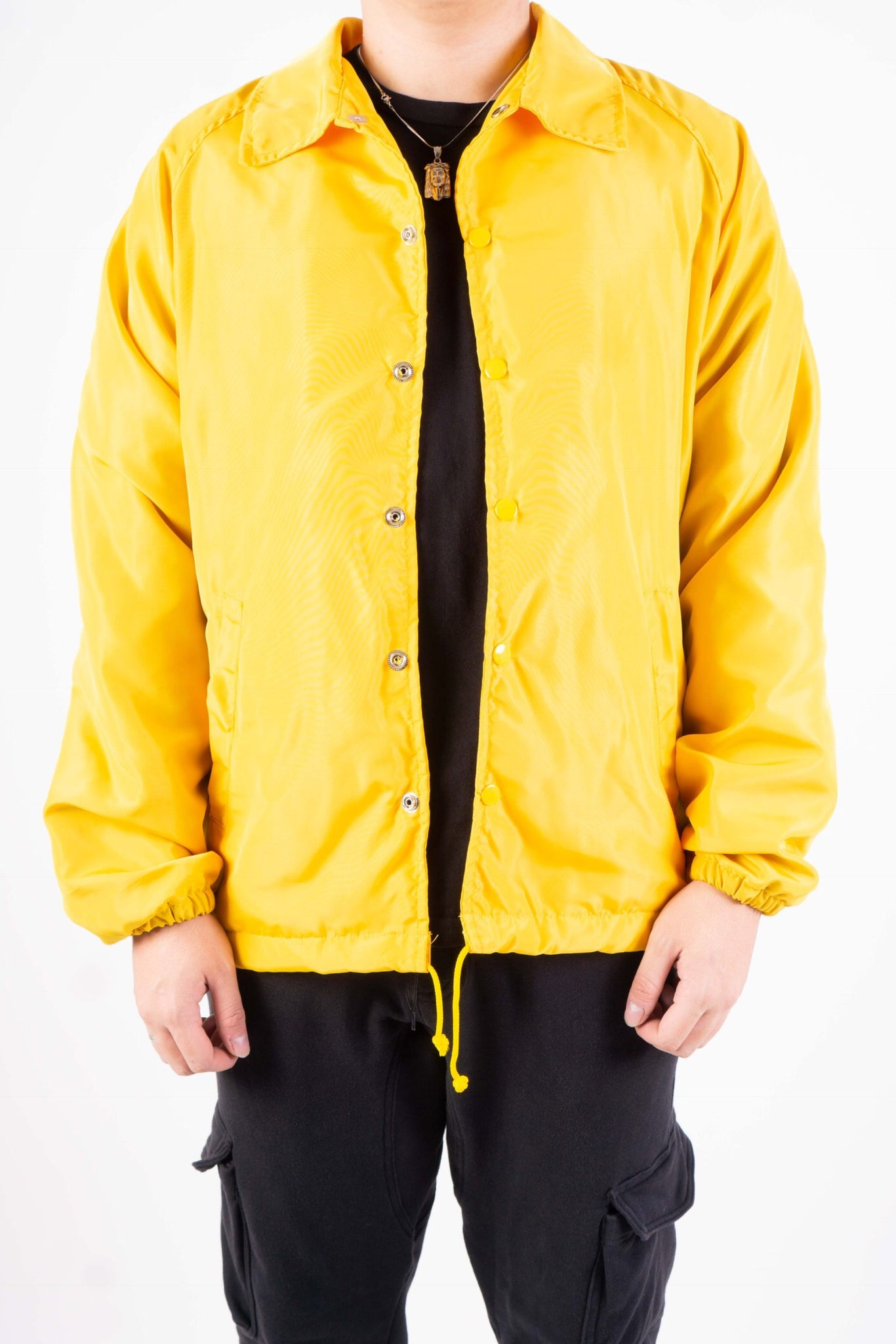 COACH JACKET IN YELLOW GOLD