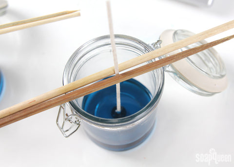 how to center a candle wick with chopsticks