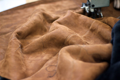 Finished leather being stitched