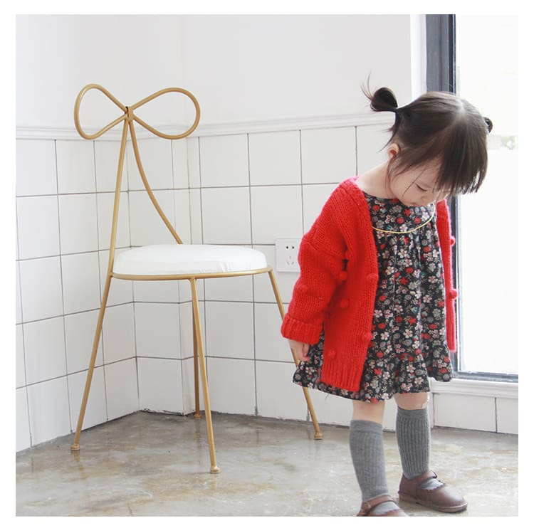 a little girl standing in a room