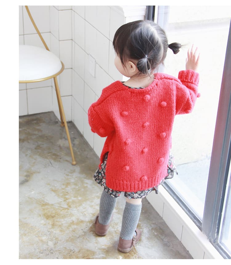 a little girl in a red shirt