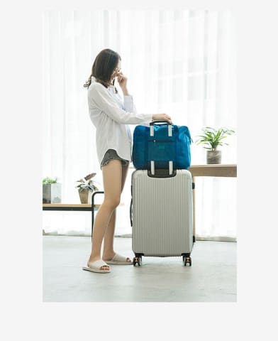 a person in a blue suitcase