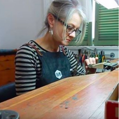 Susan Crow jewelry designer working at her bench.