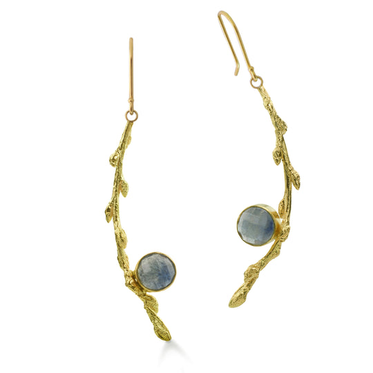 Milky-blue rose cut 6.5mm round responsibly sourced sapphires are bezel set in our Recycled 18kt gold Branch earrings with 18kt yellow gold french style ear wire. 2