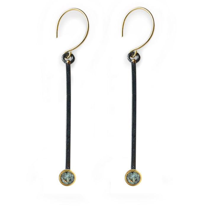 Mixed gold and silver earrings with ethically sourced Montana Sapphires. Hand-made by Susan Crow for East Fourth Street Jewelry.