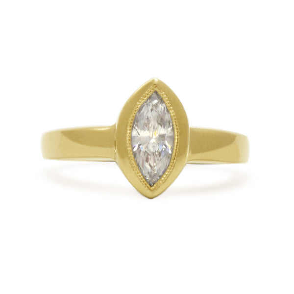 MARQUISE-CUT MOISSANITE AND GOLD RING WITH MILGRAIN EDGE, AVAILABLE IN WHITE OR YELLOW GOLD