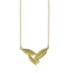 East Fourth Street Jewelry's 18kt Fairmined yellow gold and diamond pendant is the perfect size for a diamond Flora Leaf Pendant. Hand carved and cast in their Minnesota studio.