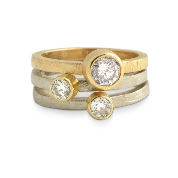 Ethical reclaimed diamonds in stacking recycled yellow and white gold rings. 3 ring set designed by Susan Crow for East Fourth Street Jewelry