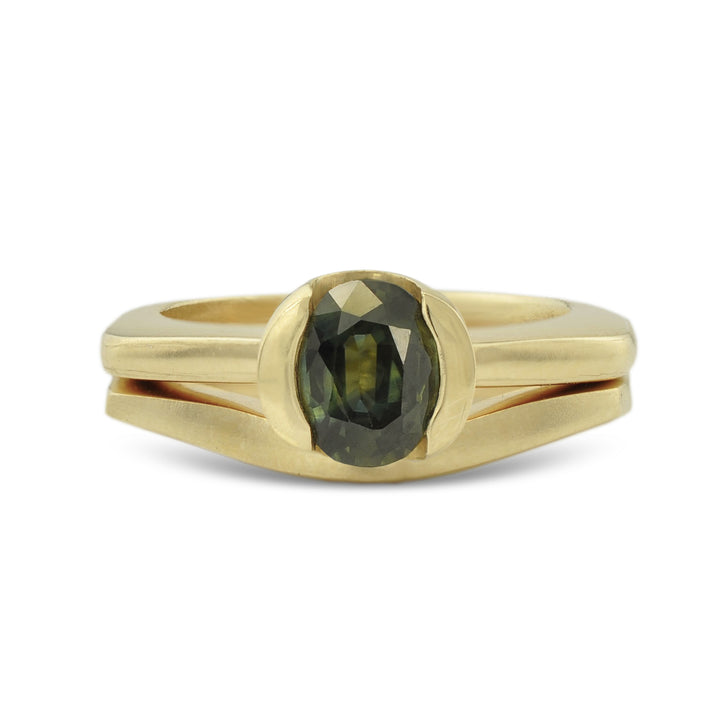 One of a Kind engagement and wedding ring set designed by Susan Crow for East Fourth Street Jewelry. 14kt Fairmined yellow gold with an oval shaped vintage green sapphire.