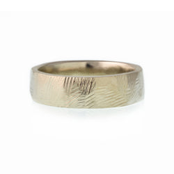 Gender Neutral hand made wedding band designed by Susan Crow for East Fourth Street Jewelry is ethically made and comfortable to wear.
