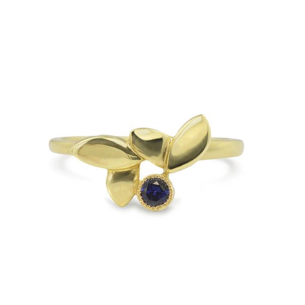 East Fourth Street Jewelry, responsibly sourced blue sapphire and 18kt Fairmined yellow gold ring. Modern Leaf design is hand carved and cast by designer Susan Crow..
