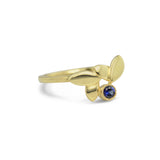 18kt Fairmined gold hand-carved ring with responsibly sourced blue sapphire