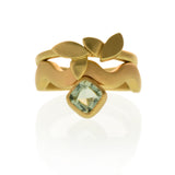East Fourth Street Jewelry, Aquamarine Wave Ring made from responsibly sourced cushion cut aquamarine set in 14kt yellow gold.