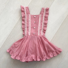 pink swiss dot pinafore with buttons and lace