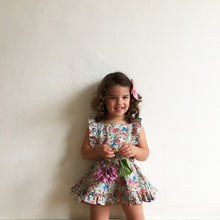pink floral pinafore