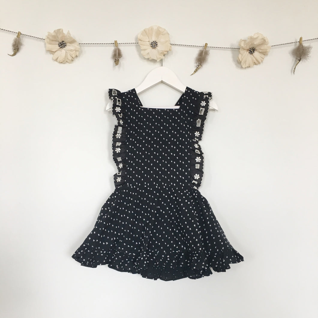 black + white swiss dot pinafore with vintage trim