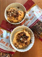 Autumn Pumpkin Fluff sprinkled with Coco, Bee & Nut and surrounded by bags of Cinnamon Cranberry Coco, Bee & Nut: Grain Free Granola