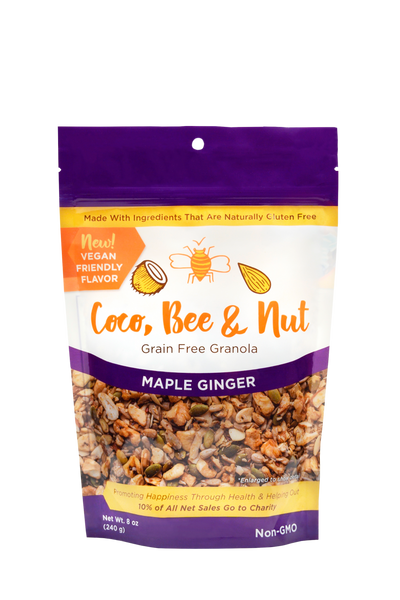 "Maple Ginger grain free/glutenfree granola is our vegan flavor. The purple color denotes this flavor; comes in an 8 oz resealable zipper bag. The front of the bag shows an enlarged photo of the loose granola detail of what you're purchasing: a rich blend of nuts and seeds, sweetened with maple syrup and flavored with a kick of ginger. Also shown on the bag is a statement reading: 10% of all sales go to charity, as well as a ""made with ingredients that are naturally gluten free"" statement."