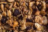 Close-up shot of Coco, Bee & Nut: Cardamom Raisin grain free granola. Oven-toasted blend of cashew, walnut and almond pieces, sunflower, pumpkin, chia, and flax seeds, small coconut flakes. Dusted with cardamom and sprinkled with sweet raisins for a warm and comforting treat.