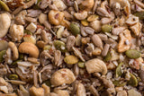 Close-up shot of Coco, Bee & Nut: Plain grain free granola. Oven-baked mix of cashew pieces, walnut and almond pieces, sunflower seeds, pumpkin seeds, small coconut flakes, chia and flax lightly coated in honey and coconut oil to give it a soft texture.