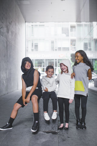 Group of cool children wearing ethical brand Ming by Ming outfits.