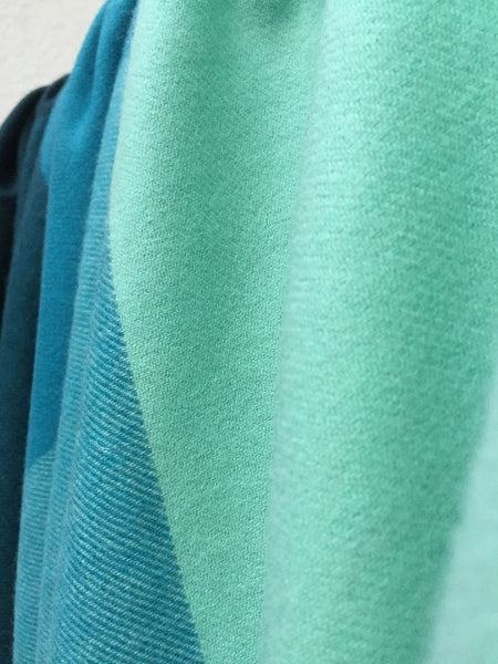 Cashmere throw wrap in turquoise and teal