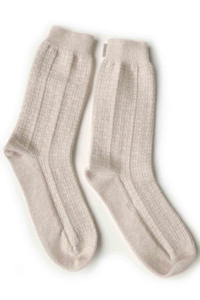 Well knit soft beige cashmere socks with comfort and warmth.