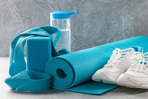 yoga essentials including a block mat water bottle and shoes