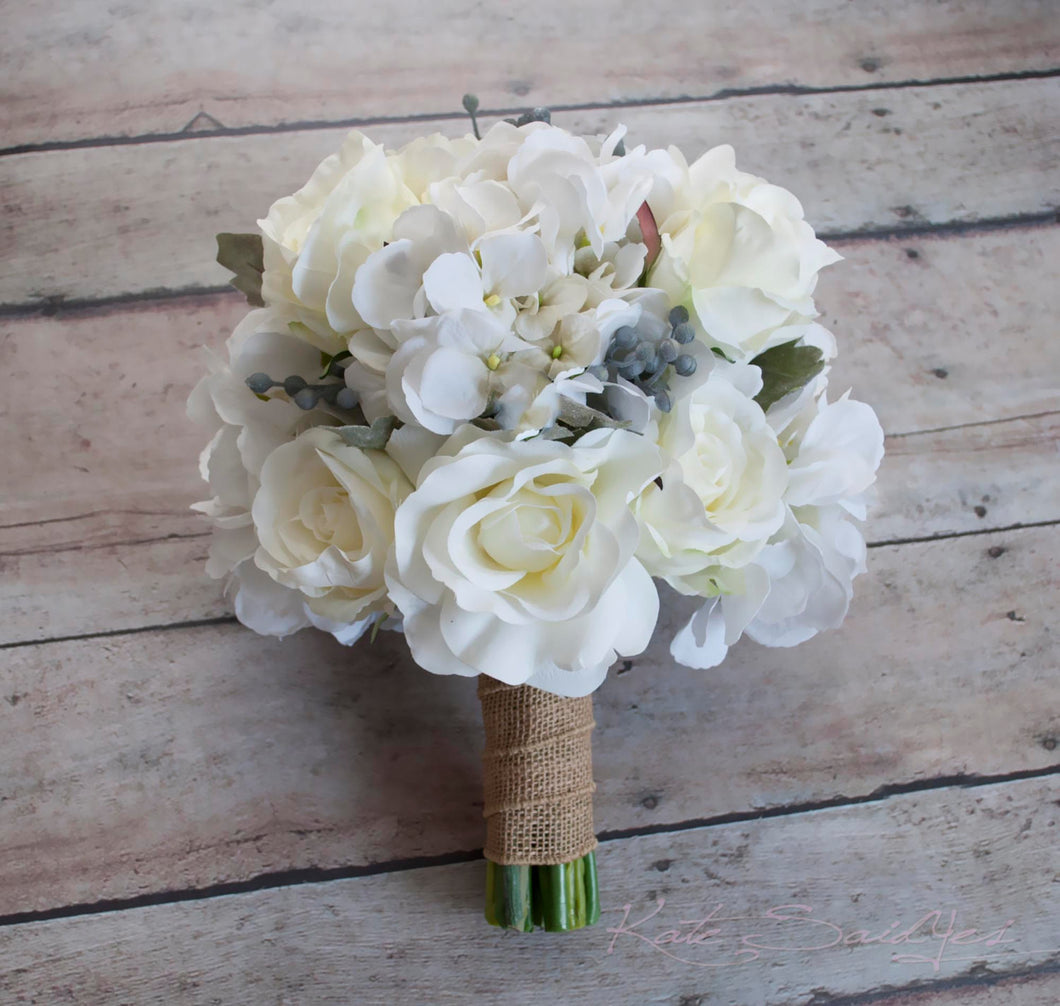 White rose and hydrangea wedding bouquet with silver