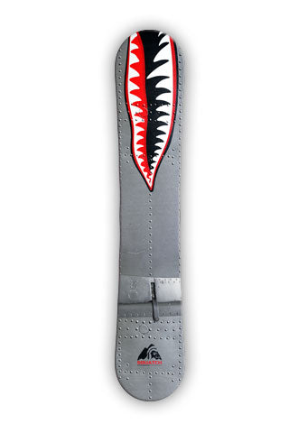 WARHAWK. This classic Warhawk snowboard wrap design was inspired by the famous P-40 Warhawk fighter plane painted with the Flying Tigers shark face. The aluminum with rivets are photos taken from the Tillamook Air Museum. Designed to look aggressive so you can attack the slopes.