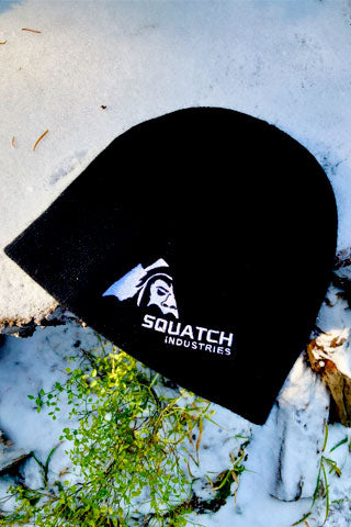 "8"" Beanie - 100% Acrylic Knit with SQUATCH Industries Logo in White embroidered on the front."