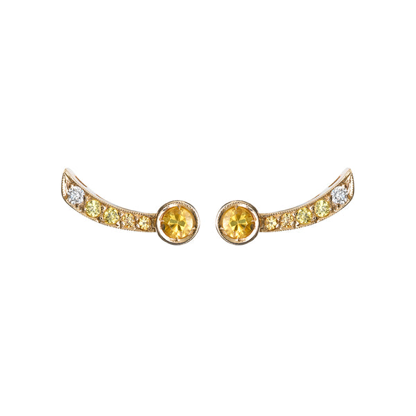 Earrings in white gold set with white diamonds and yellow sapphires