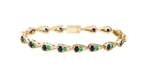 Bracelet in white gold set with white diamonds, emeralds and blue sapphires