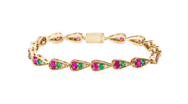 Bracelet in white gold set with white diamonds, emeralds and pink sapphires