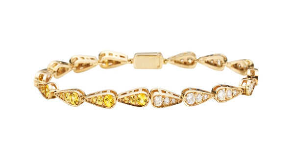 Bracelet in white gold set with white diamonds and yellow sapphires