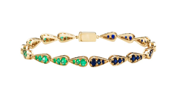 Bracelet in white gold set with emeralds and blue sapphires