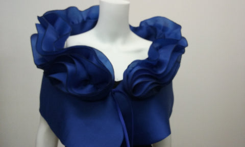 "Blue 100% silk evening wrap that has a two tiered collar at the top. A special occasion, high fashion piece, perfect for the red carpet, or your own special occasion. It measures 48"" x 14"" with a  tie closure , but can be made larger on request."