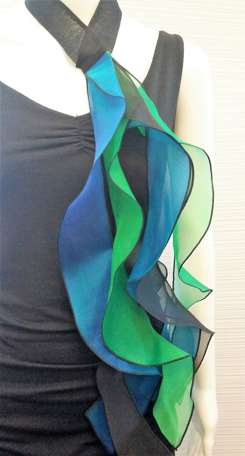 "Choker in Six 20"" long streamers in colors, blue, green, turquoise, on a black band; snap closure."