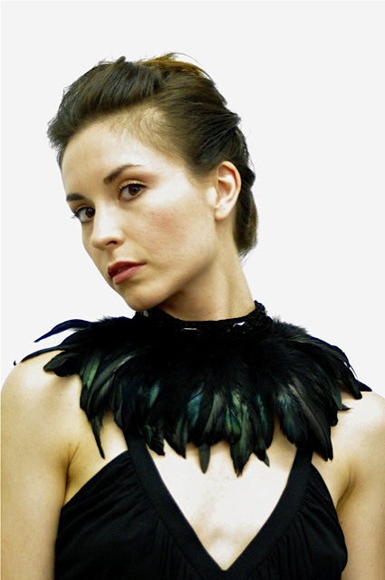 Choker with satin faced organza band and coque feathers; snap closure.