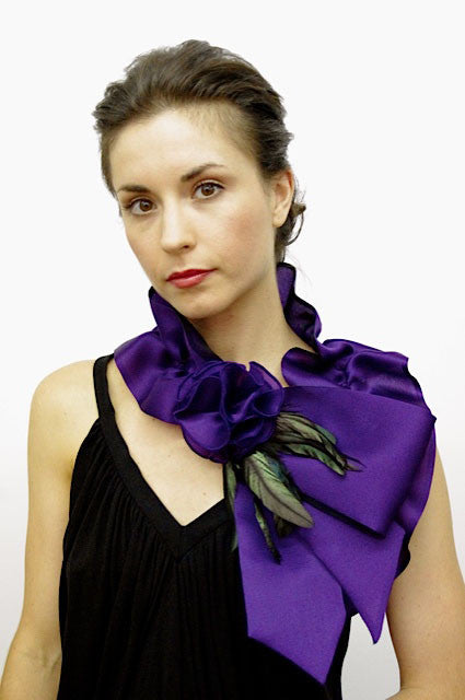 Rouched satin faced organza neck piece with flower and coque feathers; snap closure.