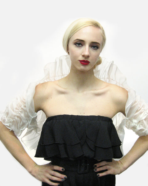 A white silk organza bridal shrug with rouched back and sleeve made with elastic thread to fit several sizes.