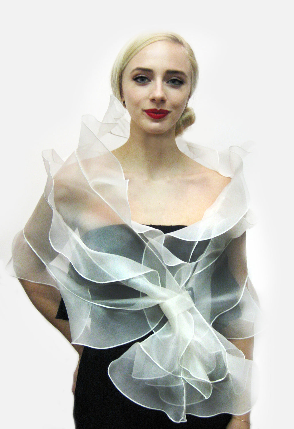 A bridal wrap made from metallic silk organza with 3 tiered ruffles and loop closure