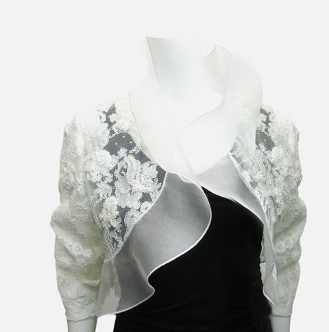 White Lace bolero jacket with hand sewn appliques, rouched sleeve and flowing ruffle collar, available in small, medium, large, extra large and in white, cream or black.  Beautiful as a bridal jacket or for any special occasion.