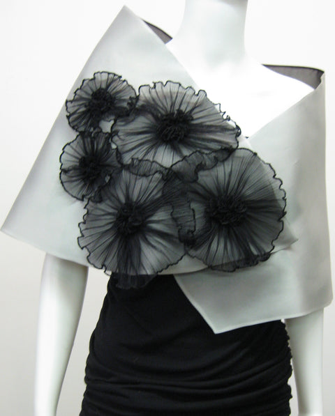 This elegant satin faced organza evening wrap is lined in silk organza and features 5 pleated flowers.