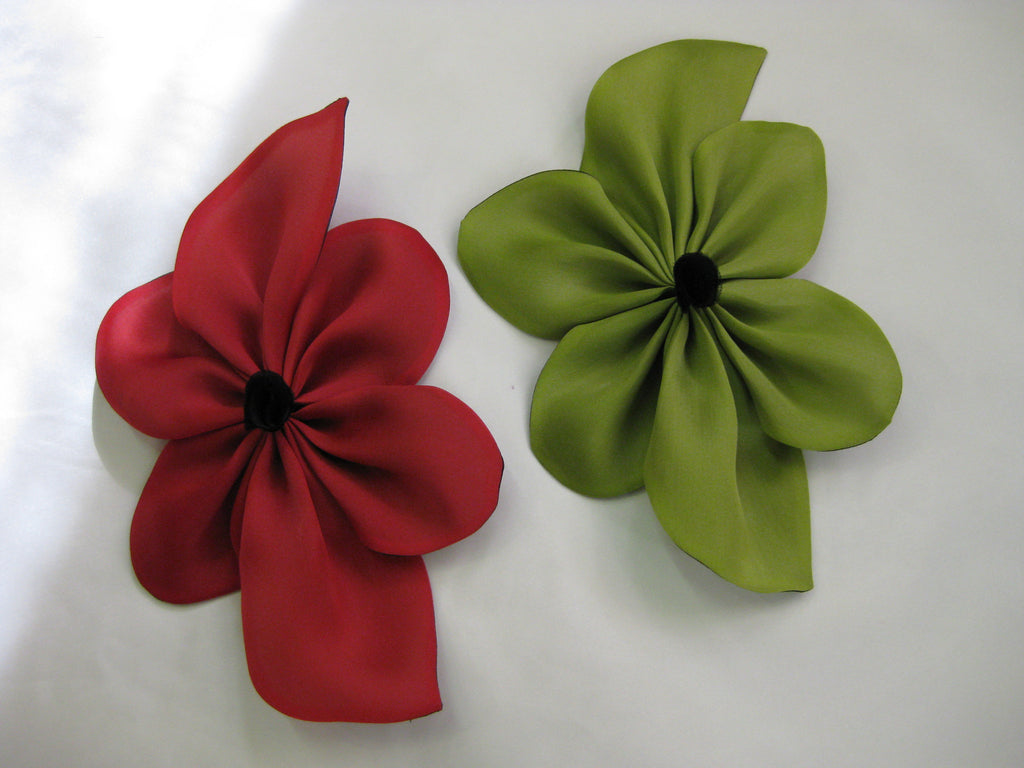 Red and Green silk flower pin with fabric center.  May be worn on sweaters, jackets, coats, hats, handbags, etc.  Hand made of satin faced organza.